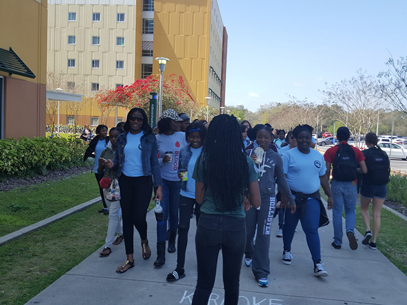 College Tour Guide Showing Students the Campus